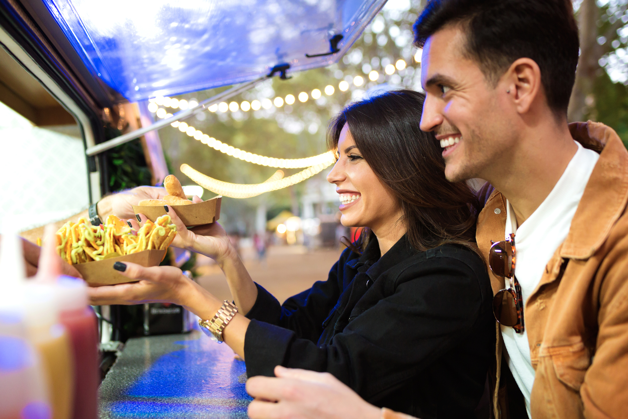 Couple getting food from food truck
